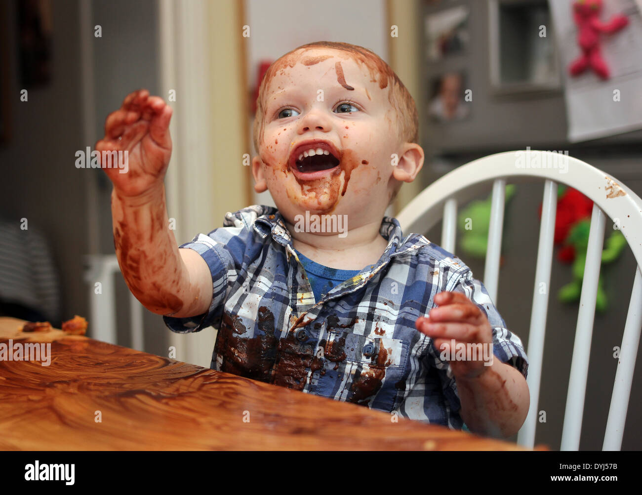 Baby covered in chocolate,illustrative editorial', bar, biscuit, break, brown, candy, caramel, chocolate, chocolate-covered, coc - Stock Image