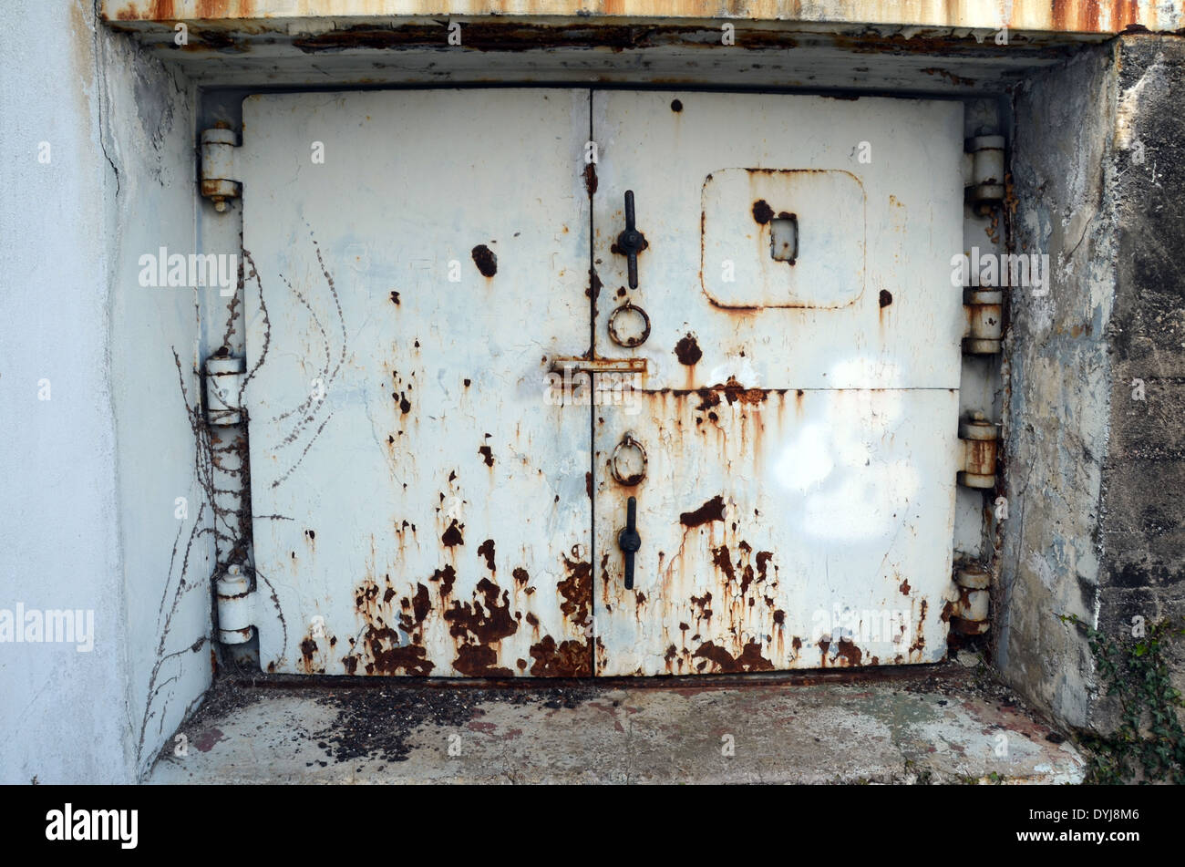 WW2 remains of the German Atlantic wall in Brittany. An armored door in Kernevel near Lorient. & WW2: remains of the German Atlantic wall in Brittany. An armored ...