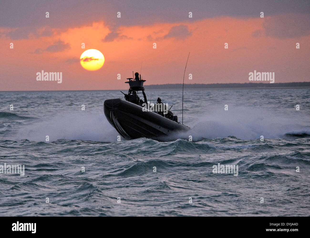 US Navy SEAL Special Warfare Combatant craft Crewmen assigned to Special Boat Team 20 navigates a rigid-hull inflatable boat film a scene in a movie production 'I Am That Man' July 9, 2008 in Key West, Florida. - Stock Image
