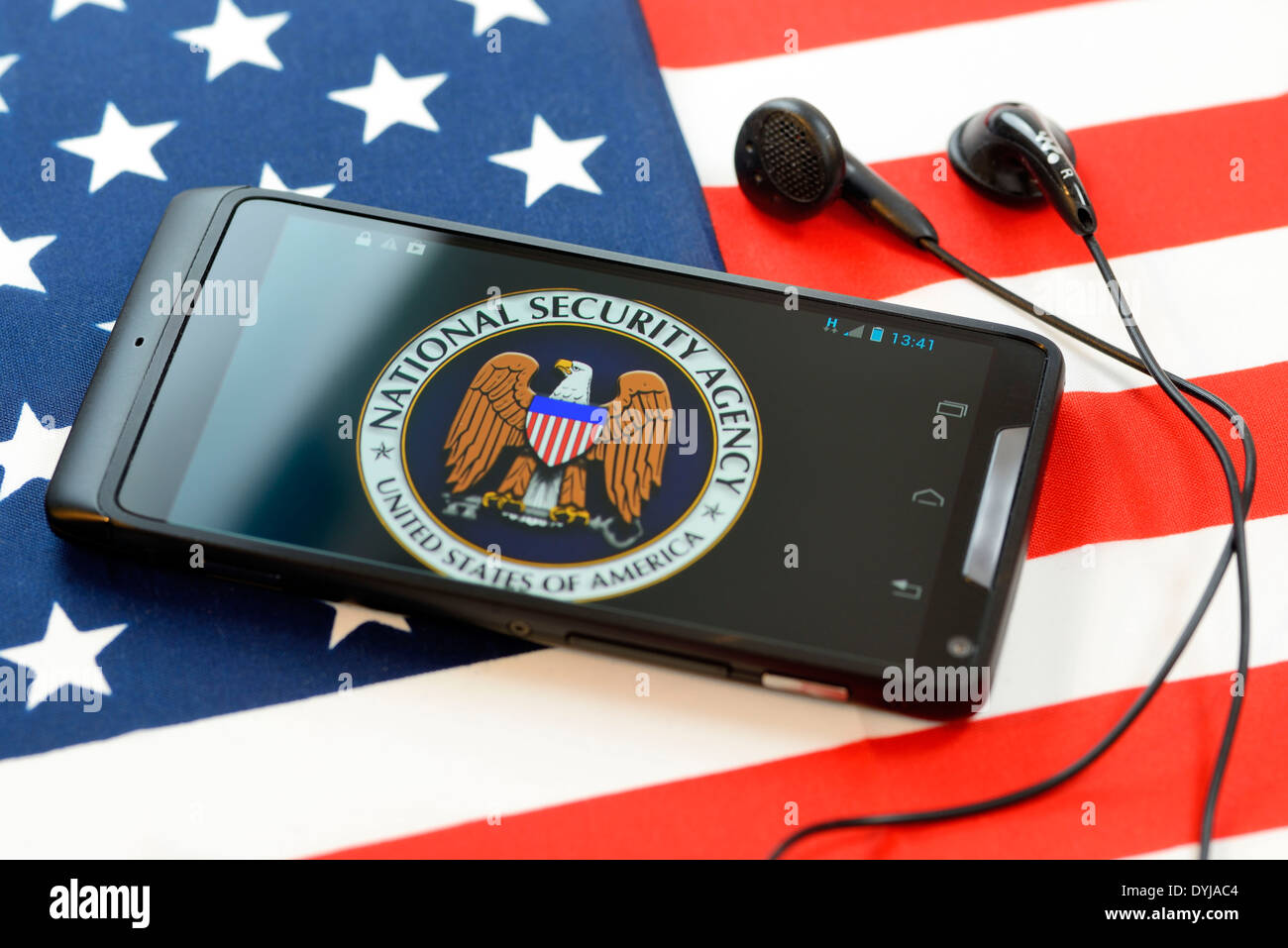Phone with NSA logo on U.S. flag, listening affair, Handy mit NSA-Logo auf US-Fahne, Abhöraffäre - Stock Image