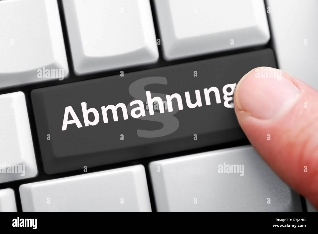 Computer button with the inscription warning, Computertaste mit der Aufschrift Abmahnung Stock Photo