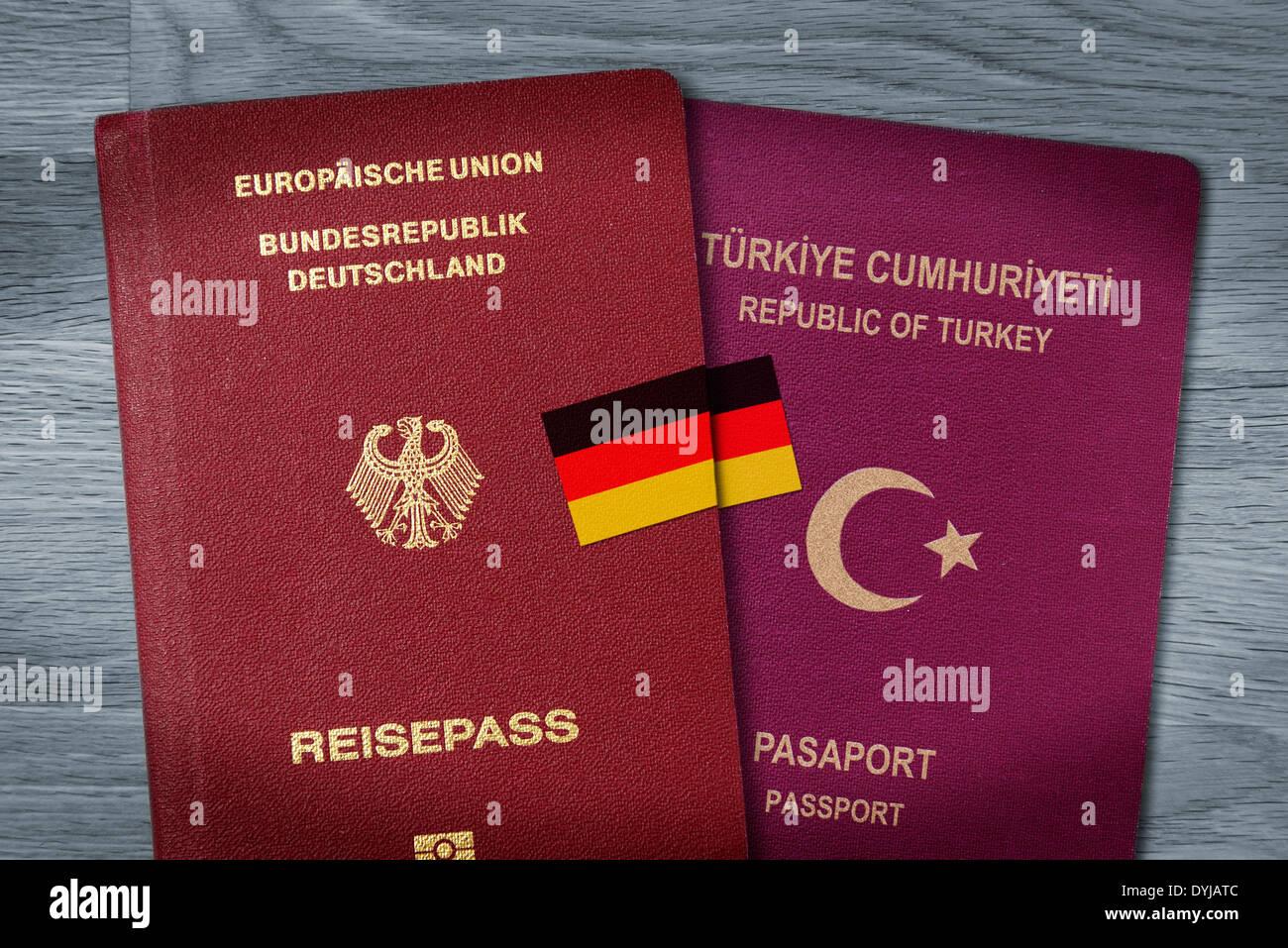 German and Turkish passport, dual citizenship, Deutscher und türkischer Pass mit Deutschlandfahne, doppelte - Stock Image