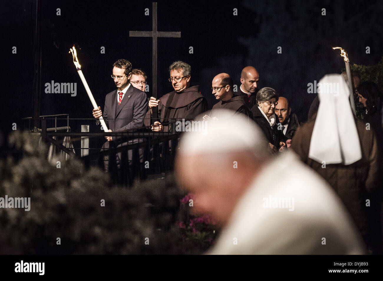 "April 18, 2014 - Rome, Italy """""" April 18, 2014: Faithful hold the cross during a station during the Via Crucis Stock Photo"