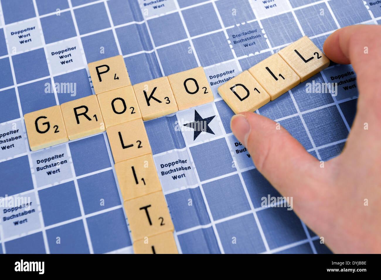 Hand legt das Wort GroKoDil, Symbolfoto Machtkämpfe in der Großen Koalition - Stock Image