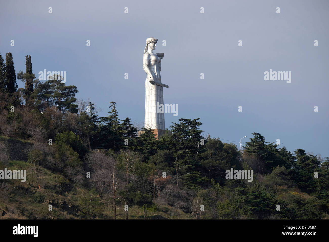 The 23-meter-high statue of Kartlis Deda (Mother Georgia) holding a sword for her enemies in her right hand and a bowl of wine to greet friends in her left overlooking the city of Tbilisi the capital of  Republic of Georgia - Stock Image