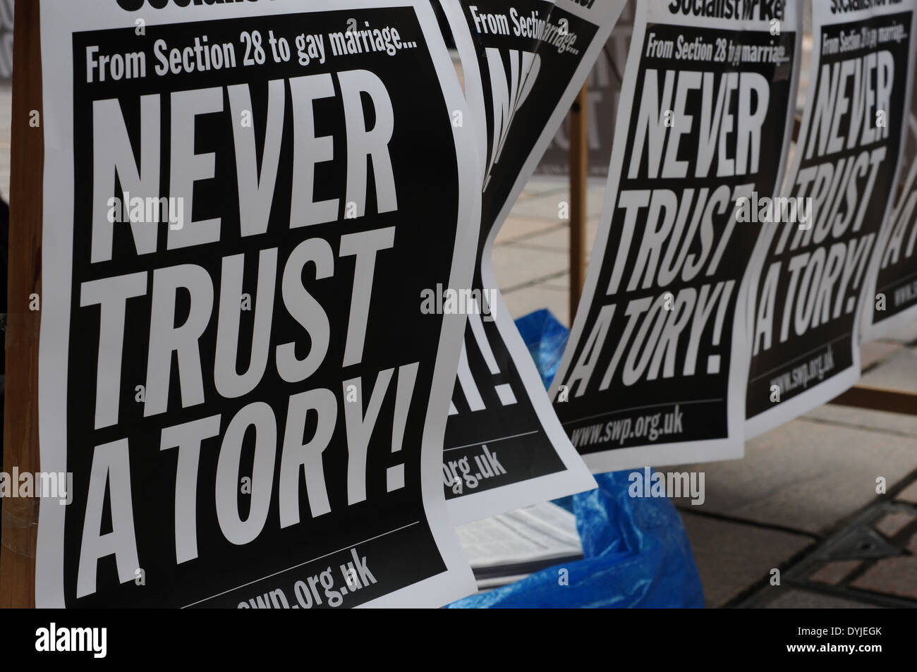 Never trust a tory posters attached to a table. A counter protest was held during a British National Party campaign in the city of Glasgow. - Stock Image
