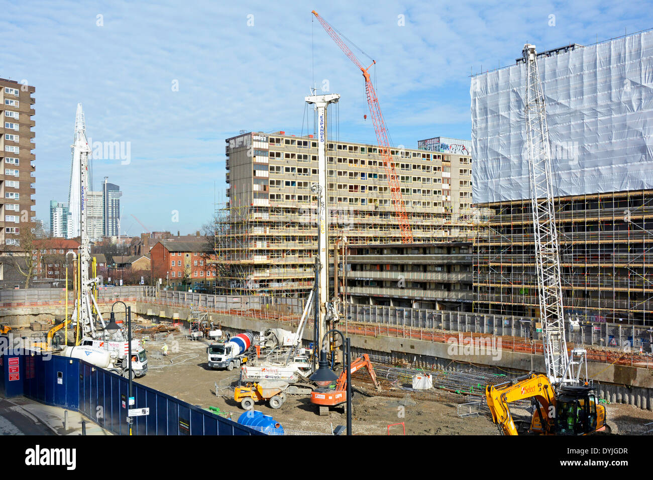 Regeneration work started on part of the site of old Heygate Estate with remaining blocks beyond being prepared for demolition - Stock Image