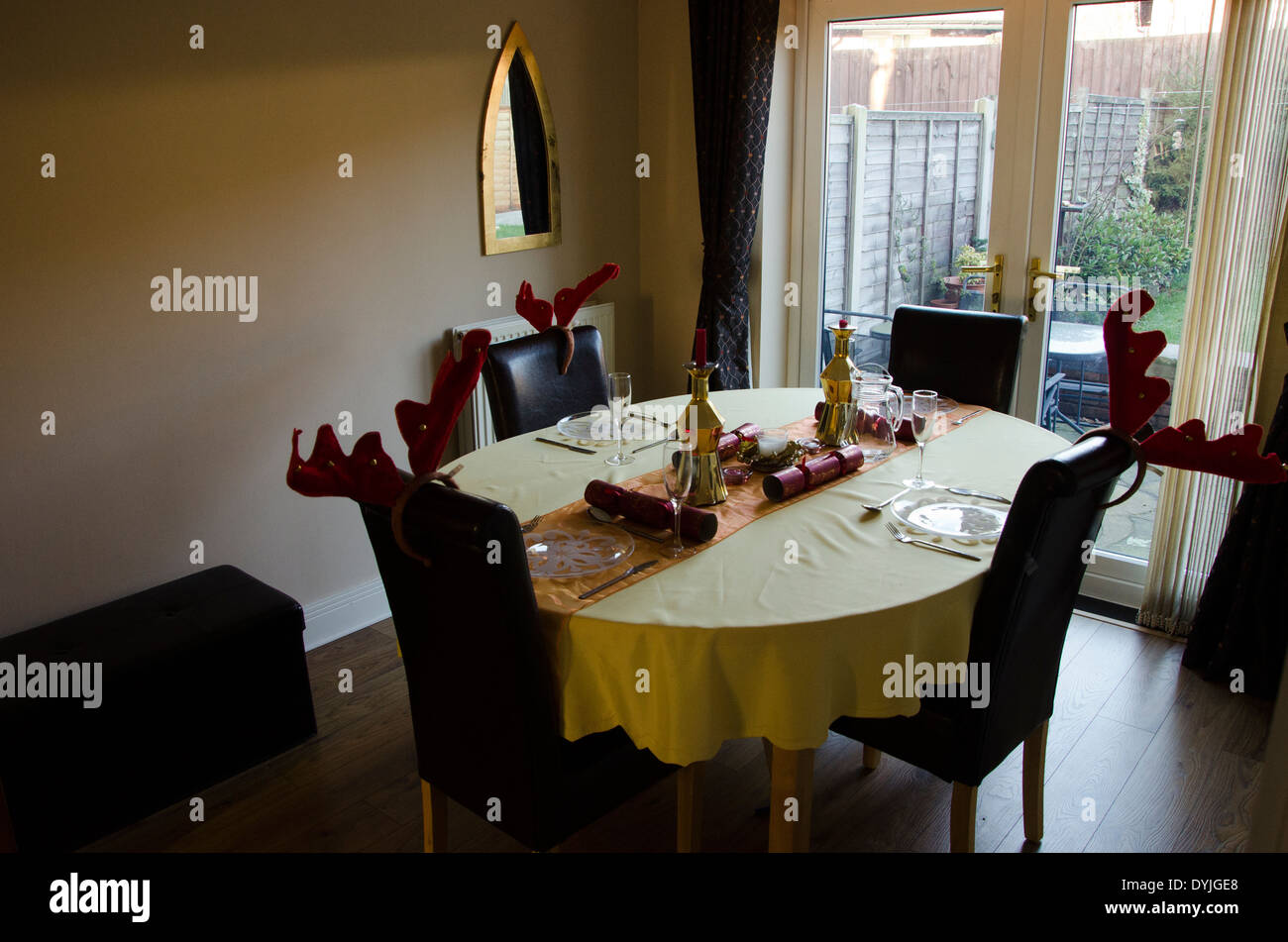 Dining table . Places set ready for Christmas meal - Stock Image