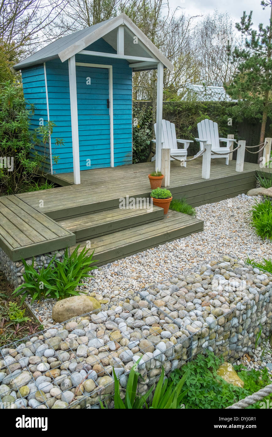 Small modern low maintenance garden with seaside theme and beach hut ...