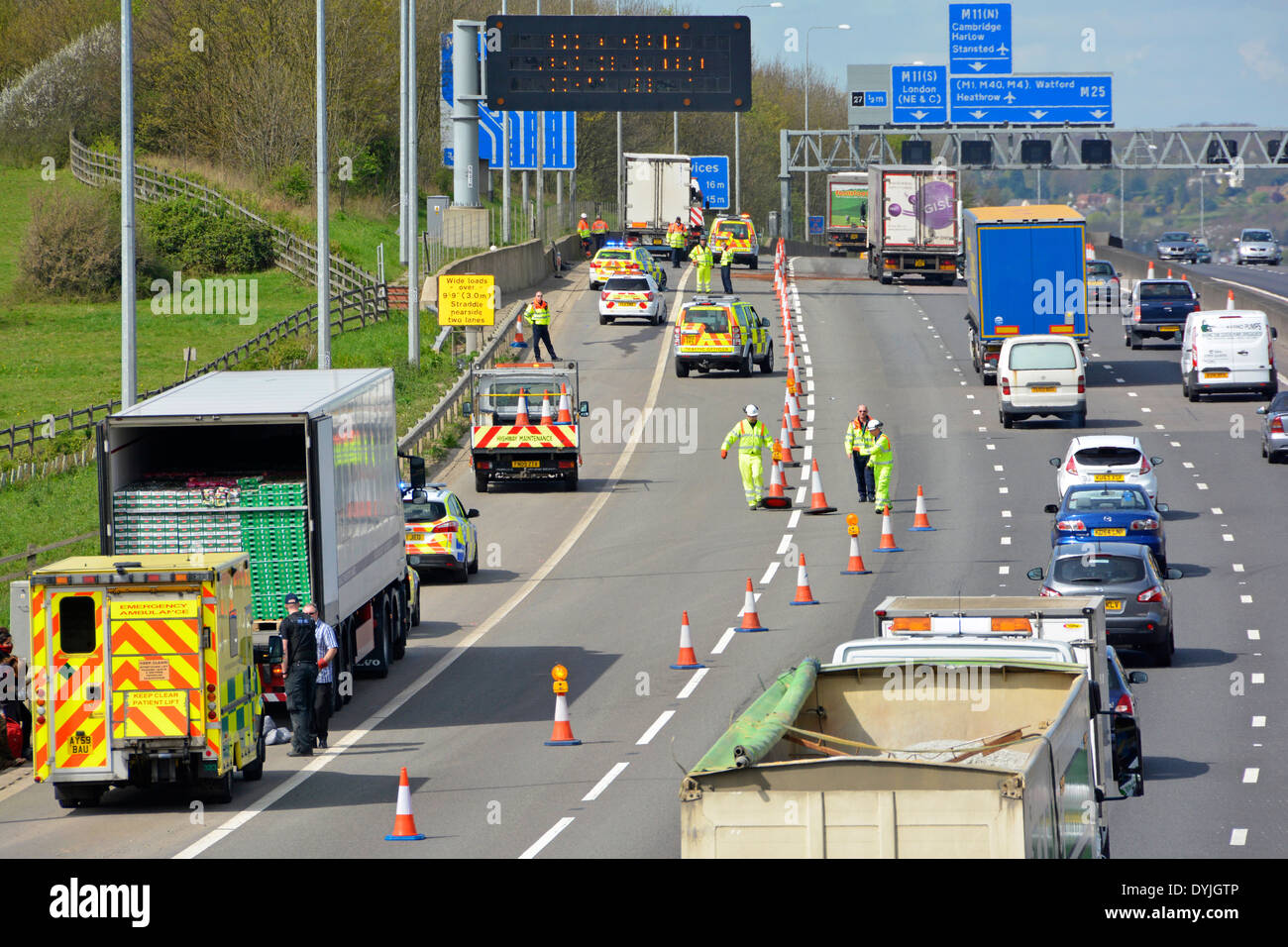 Reopening part of M25 motorway after accident (distant) and ongoing police lorry search incident (closest) on the hard shoulder - Stock Image