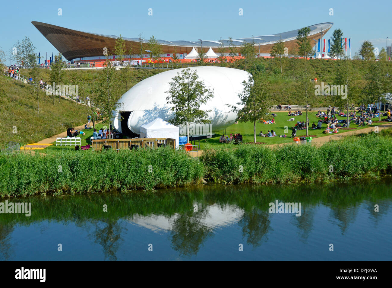 London 2012 Olympic Park during Paralympic events with views across the River Lea with bandstand and Velodrome beyond - Stock Image