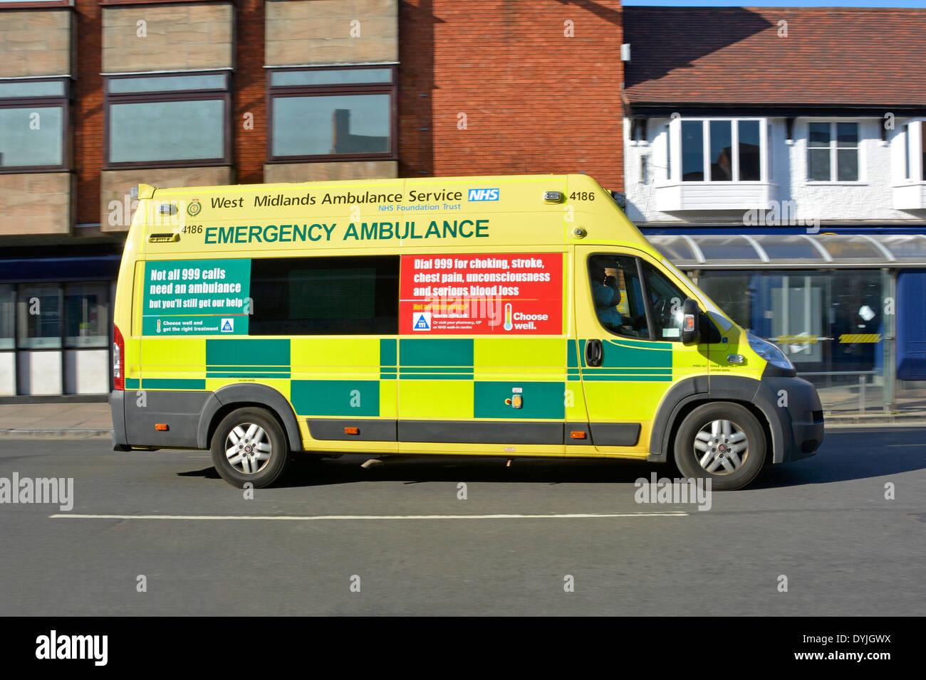 West Midlands NHS emergency ambulance with advertising panels explaining the correct use of 999 calls Stratford upon Avon Warwickshire England UK - Stock Image