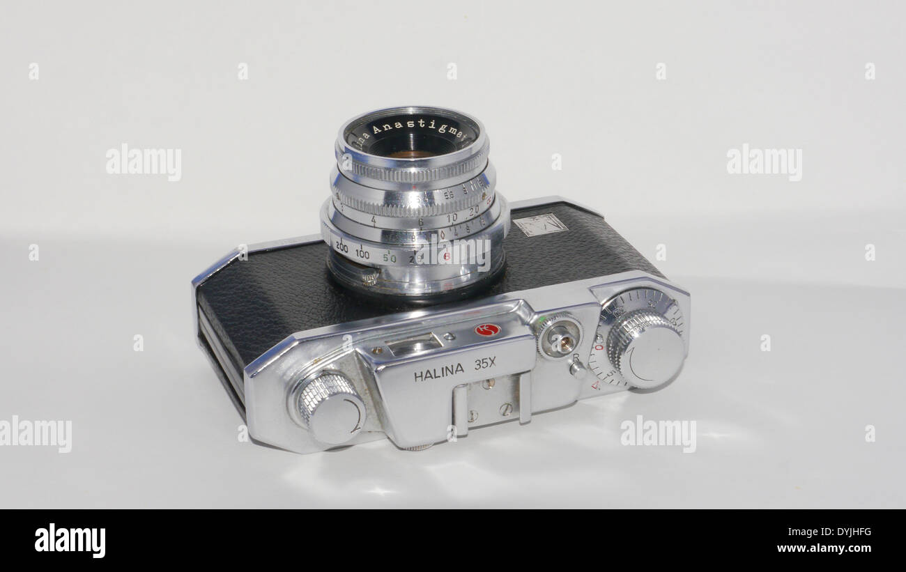 Halina X35 analogue 35mm camera, photographed against white background -  view of top plate and Anastigmet lens - Stock Image