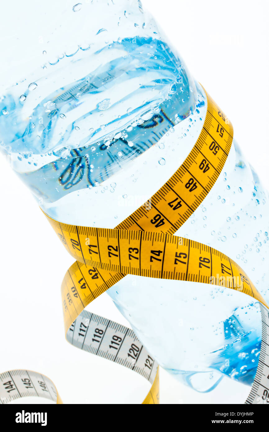 A plastic bottle of mineral water and measuring tape. Symbol diet., Massband; Zentimermass; - Stock Image
