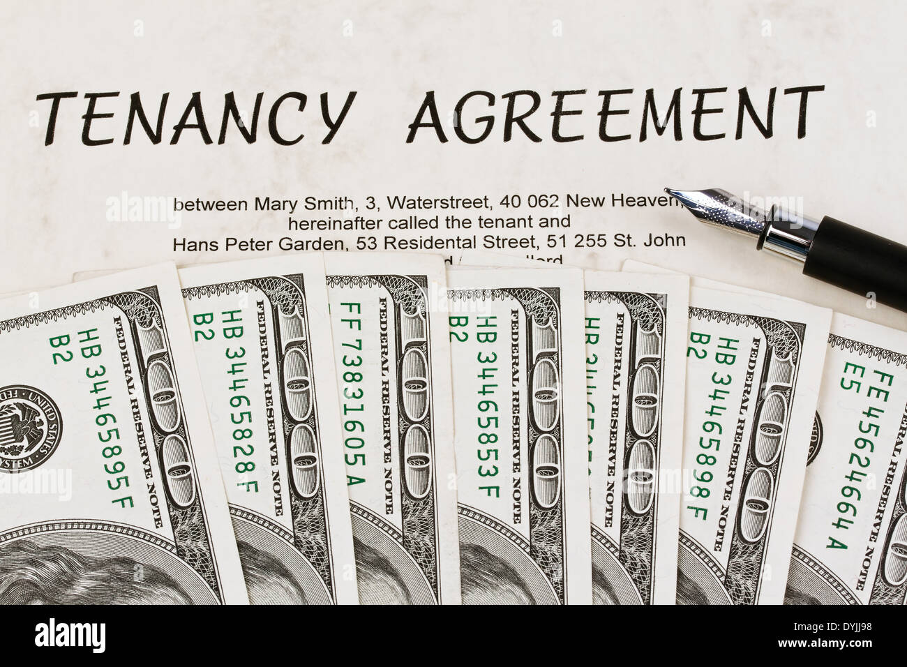 U.S. dollar bills and English lease contract, Dollar Geldscheine und englischer Mietvertrag - Stock Image
