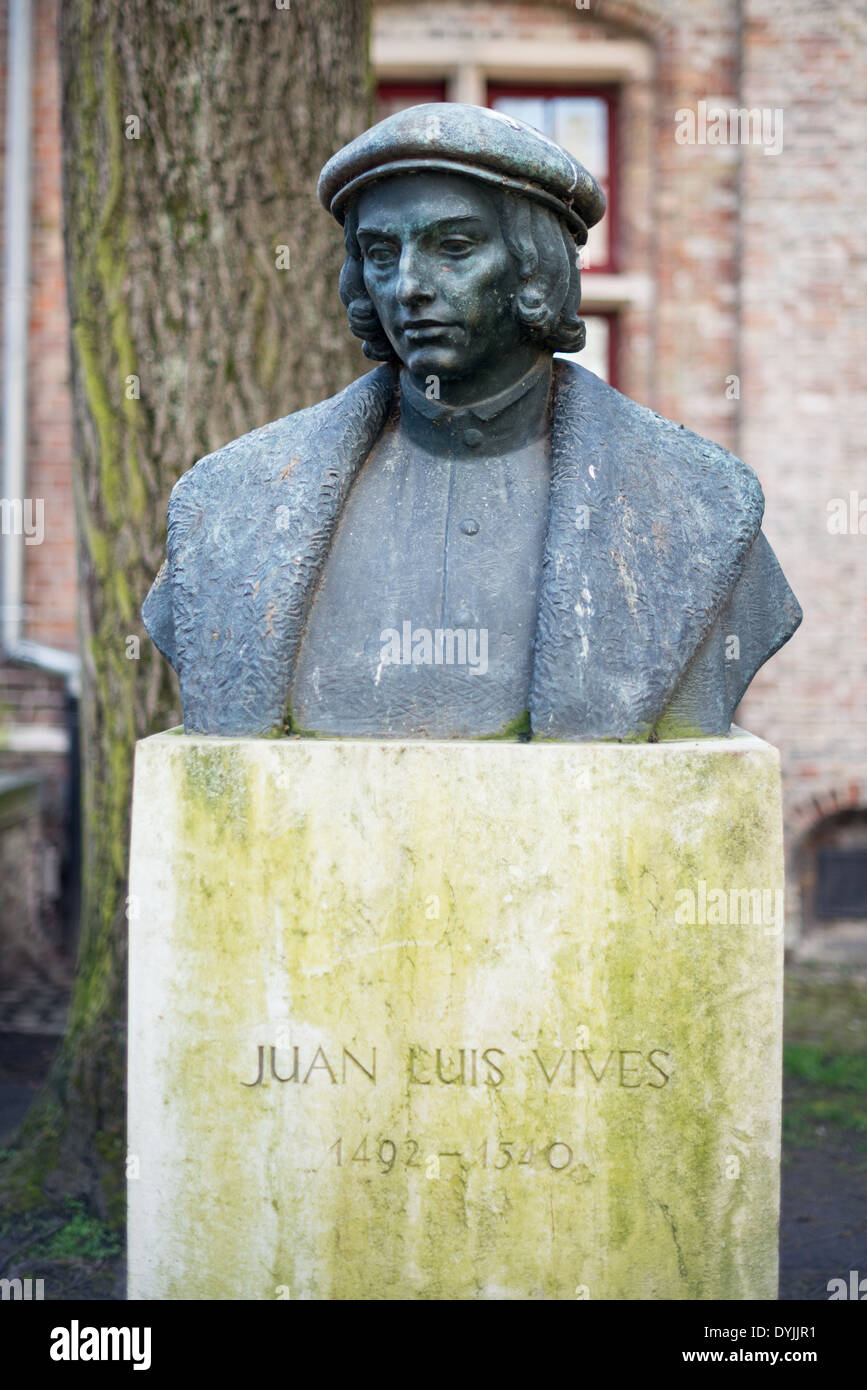 BRUGES, Belgium - A statue of Juan Luis Vives (1493 – 1540) in Bruges. He was a Valencian scholar and humanist who spent most of his entire adult life in the Southern Netherlands. His beliefs on the soul, insight to early medicine practice, and perspective on emotions, memory and learning earned him the title of the 'father' of modern psychology. - Stock Image