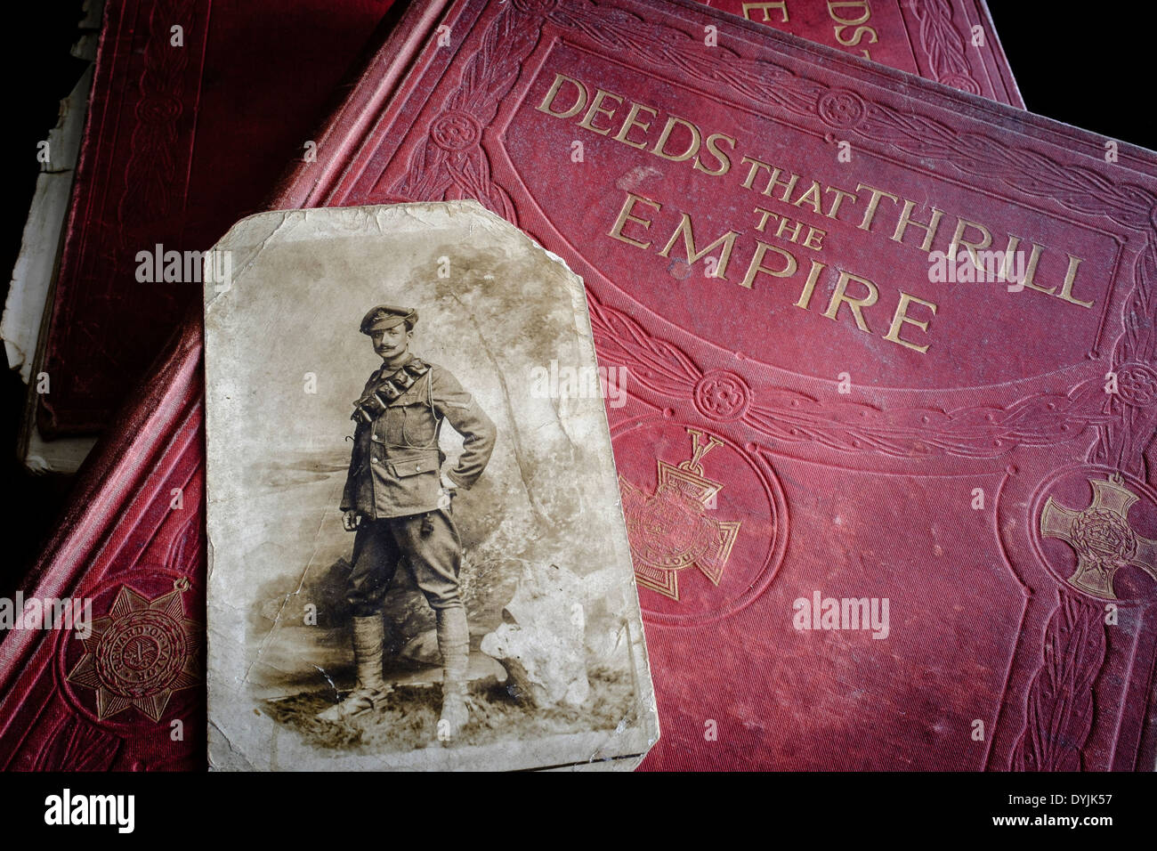 Photograph of John Edward William Samuels (DCM, MM), Royal Field Artillery, on volume of Deeds That Thrill The Empire in which he featured. - Stock Image