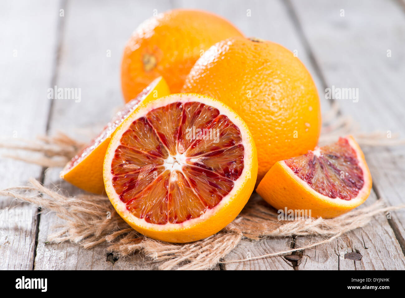 Fresh piece of juicy Blood Orange (close-up shot) - Stock Image