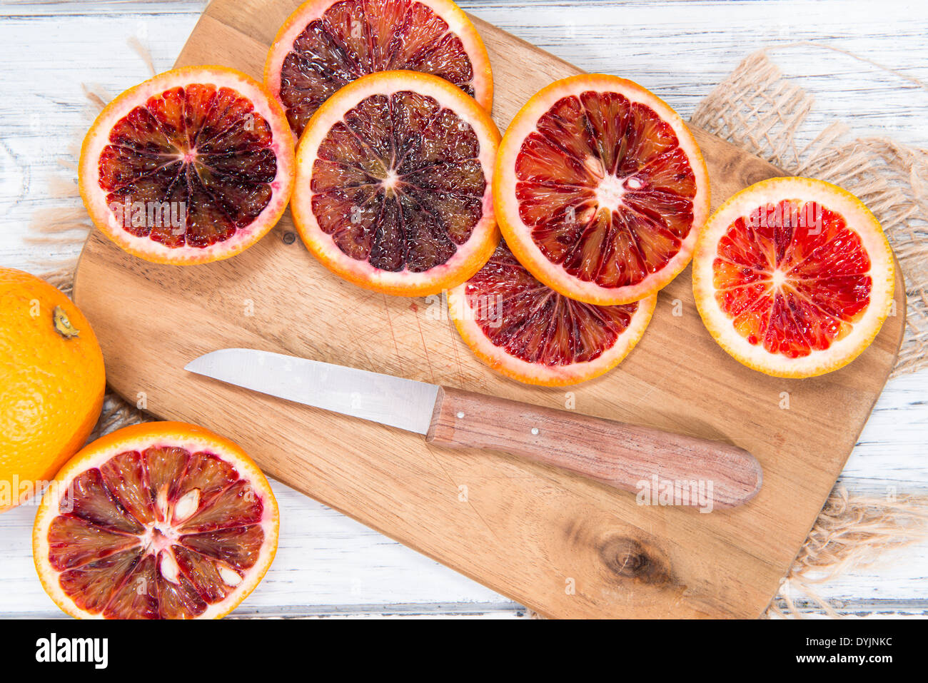 Fresh Blood Oranges on wooden background - Stock Image