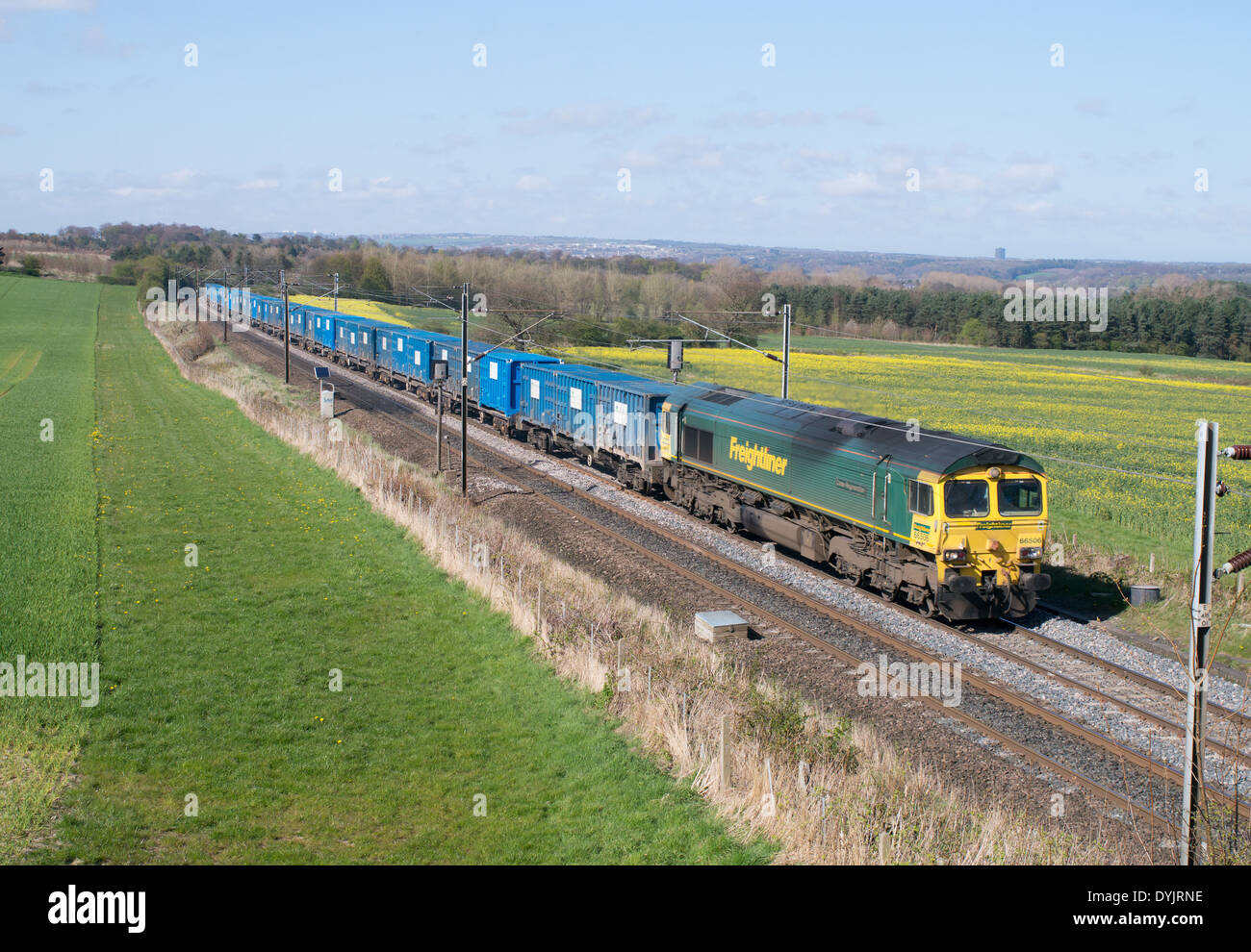 Binliner freight train thought to be used to carry domestic landfill waste from Manchester to Scotland at Plawsworth England UK - Stock Image