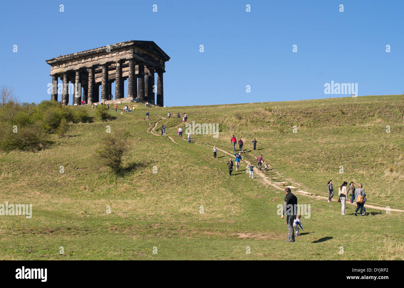 People walking up Penshaw Hill Easter weekend Sunderland north east England UK - Stock Image