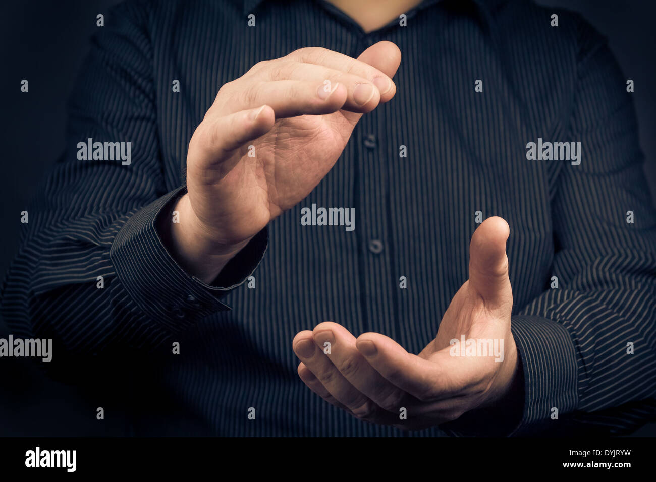Man expressing their appreciation by clapping hands - Stock Image