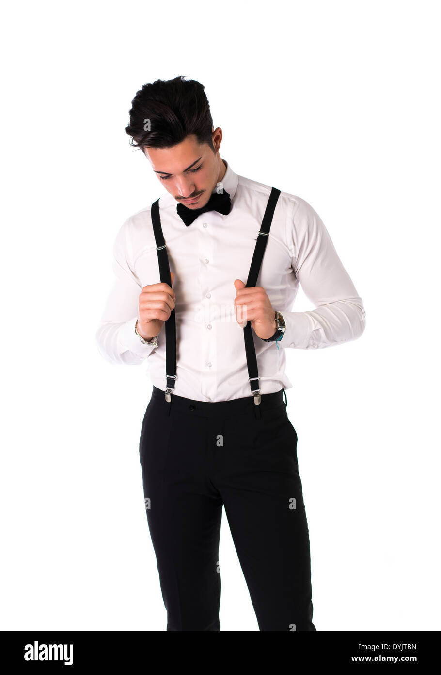 edce01a14511 Handsome elegant young man with suit, bow-tie and suspenders, isolated on  white