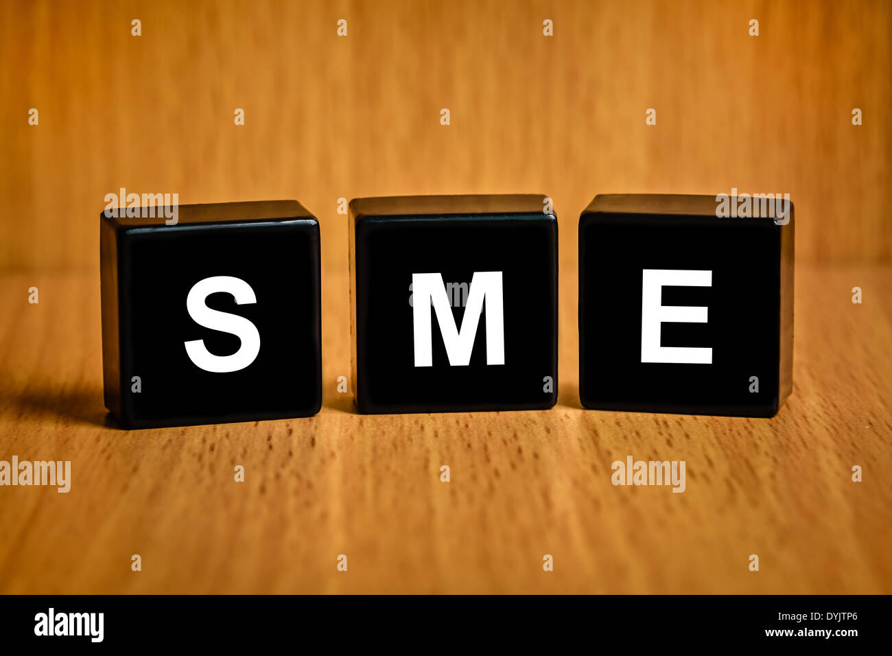 SME or Small and medium enterprises text on black block - Stock Image