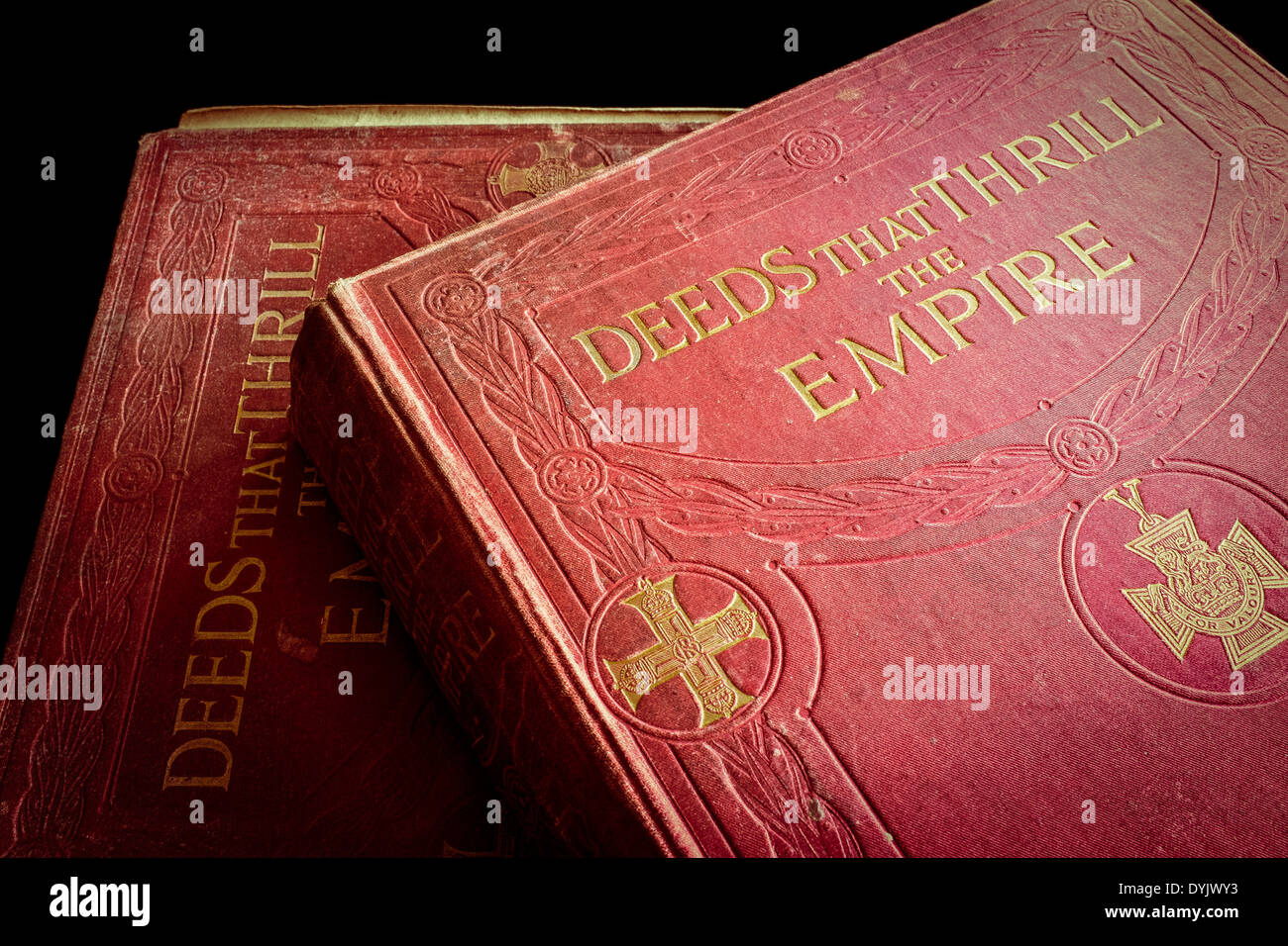 Two original volumes of  'Deeds that Thrill the Empire' - Stock Image
