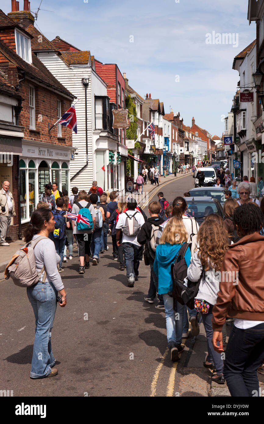 UK, England, East Sussex, Rye, High Street, party of schoolchildren crossing the road - Stock Image