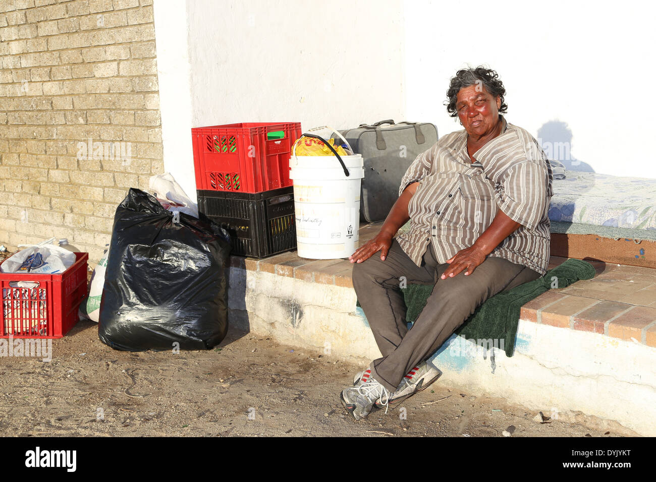 HOMELESS MIXED RACE ELDERLY WOMAN IN CAPE TOWN - Stock Image