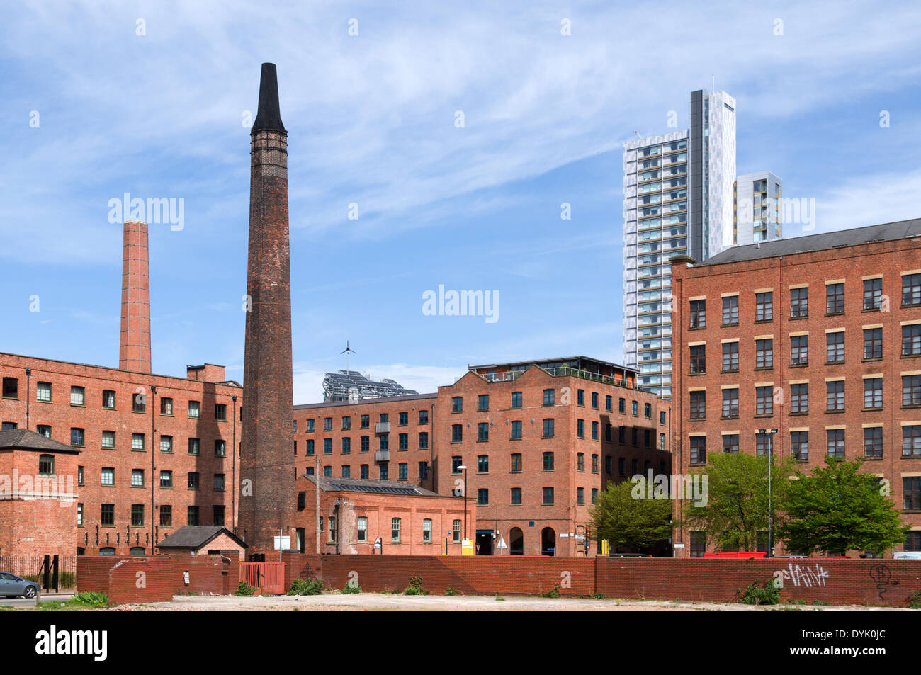 The former Macintosh Mill (now apartments) and Student Castle buildings, Manchester, England, UK - Stock Image