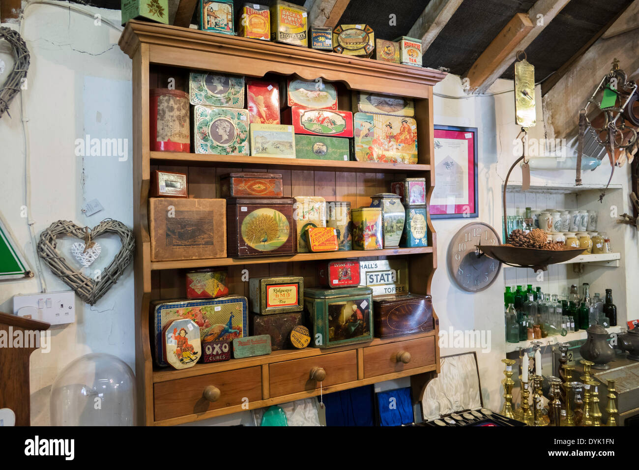 Interior of a rural antique shop with a collection of vintage decorated storage tins - Stock Image