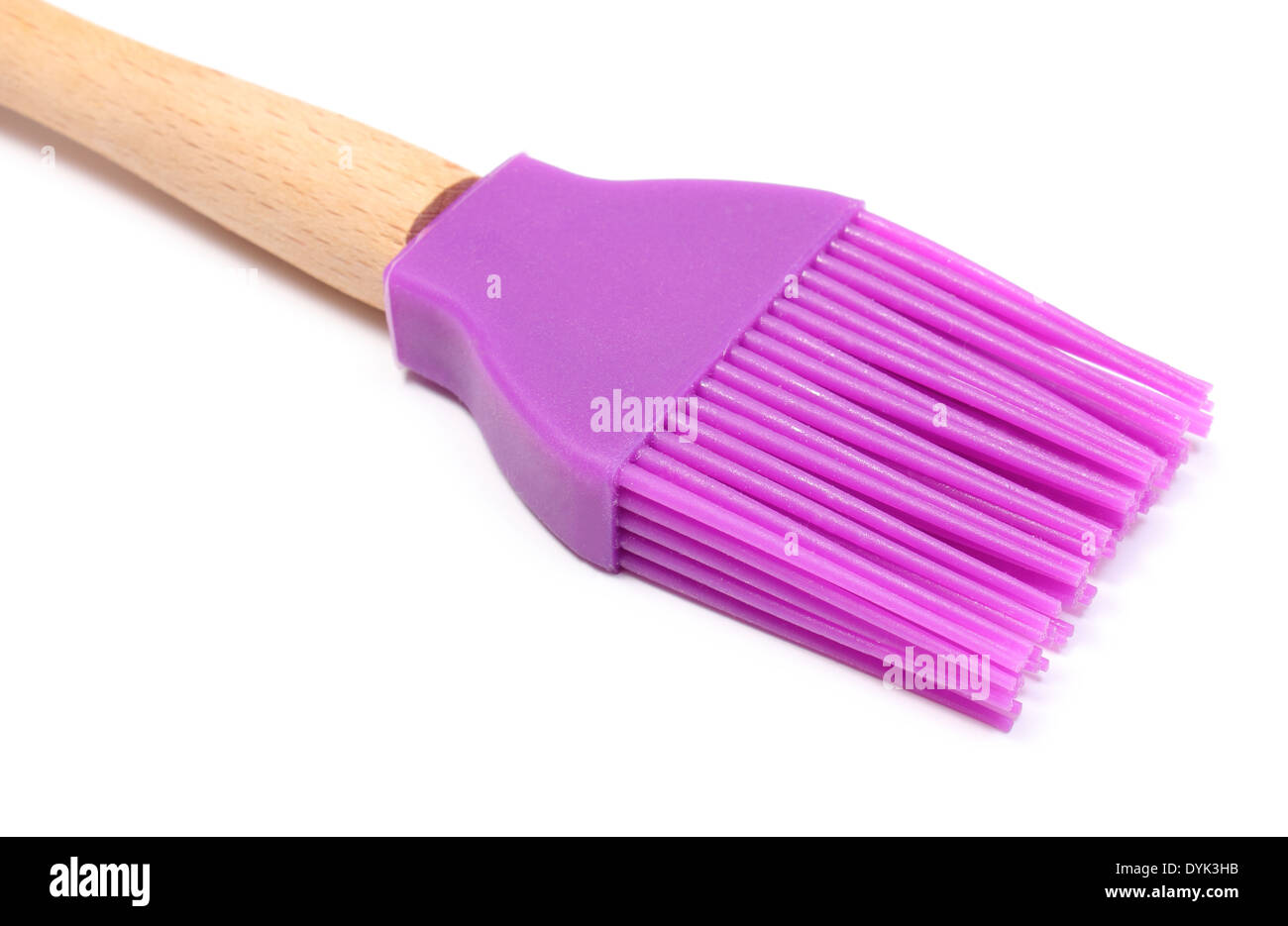 Closeup of purple silicone kitchen accessories, brush lying ...