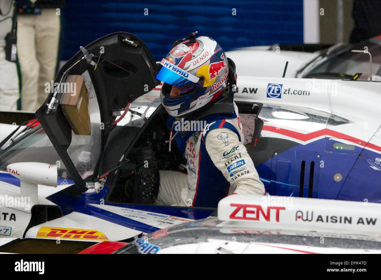 Silverstone, UK. 20th Apr, 2014. Sebastien Buemi climbs out of his Toyota after winning round 1 of the World Endurance Stock Photo