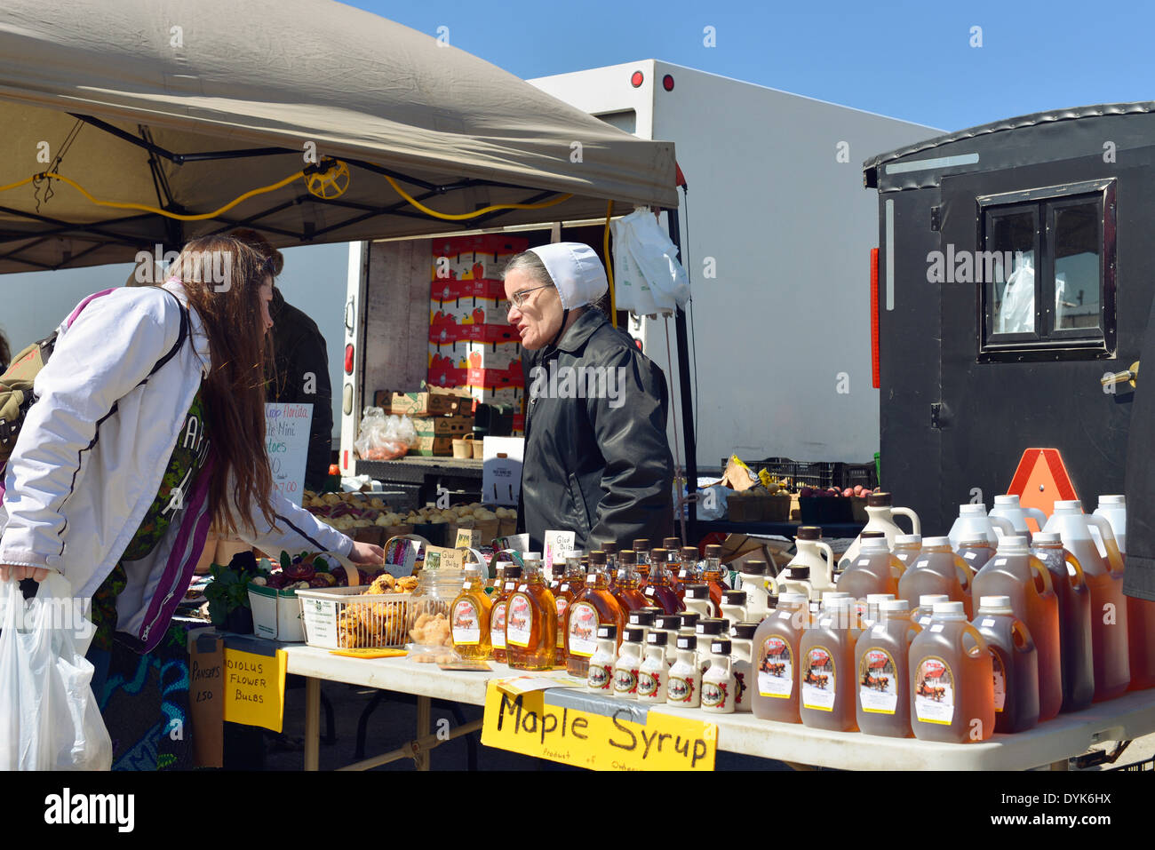 Mennonite Woman selling Maple Syrup, St. Jacobs Farmers Market, Ontario - Stock Image