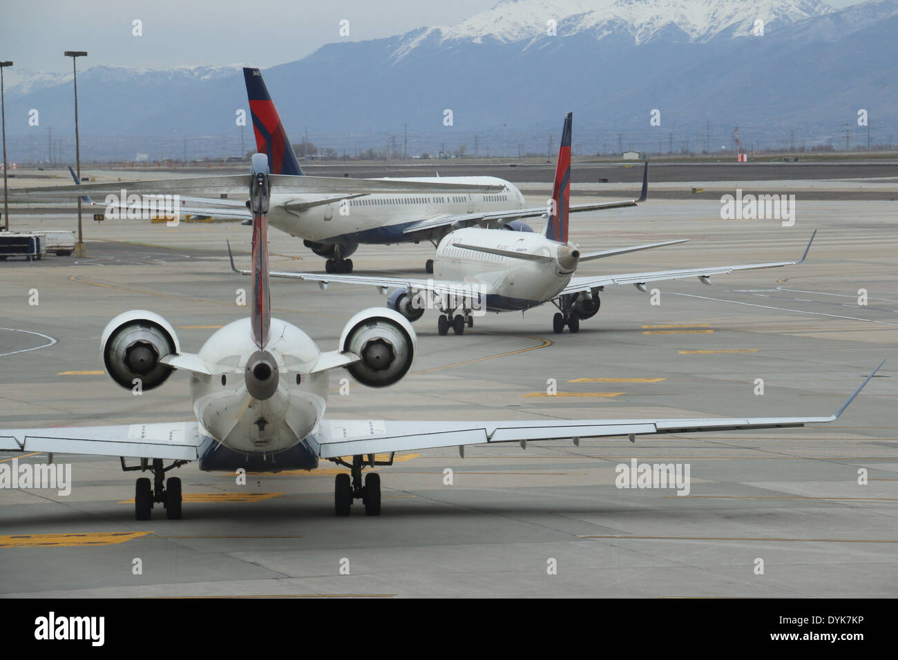 Jet airliners in line on tarmac airport Salt Lake City Utah - Stock Image