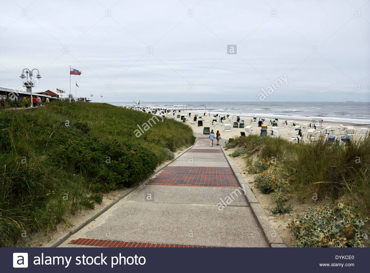 Strandkörbe, beach chairs, on the sandy beach of Insel Wangerooge. - Stock Image