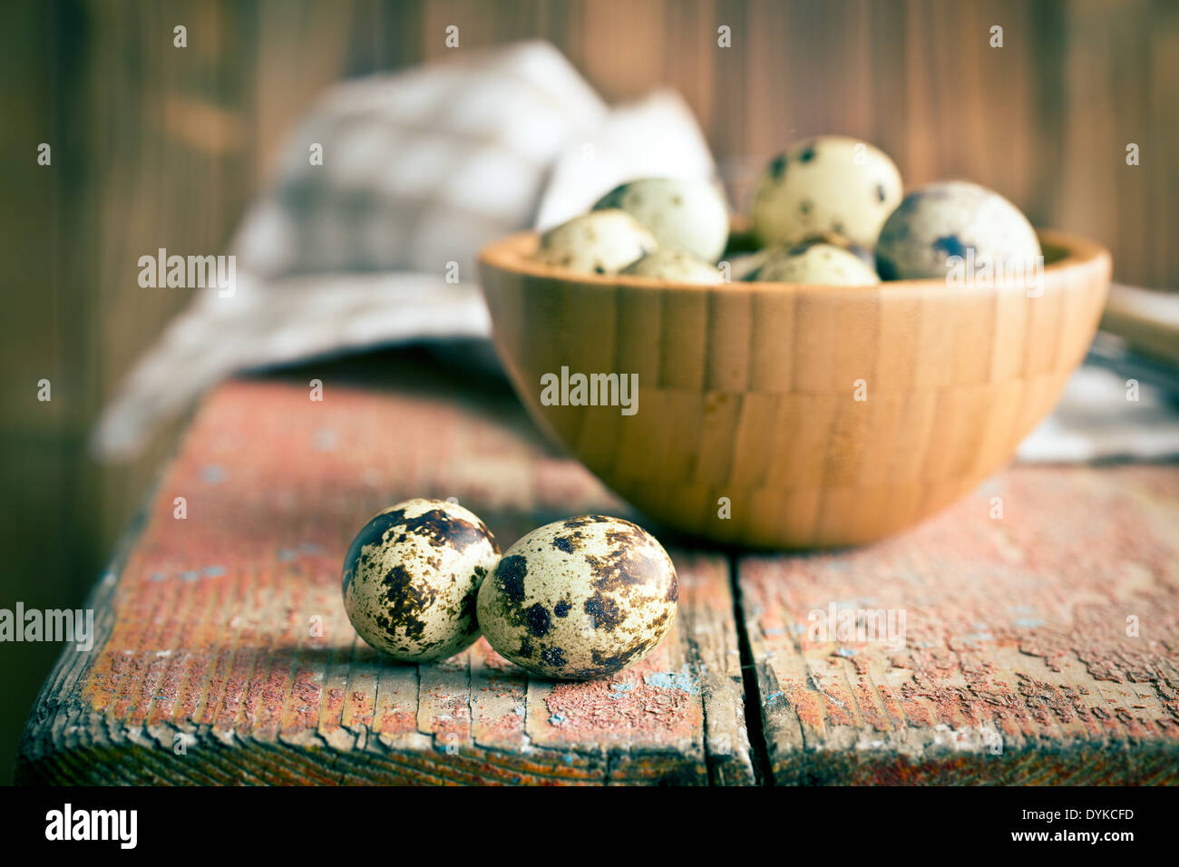 the quail eggs on old wooden table - Stock Image