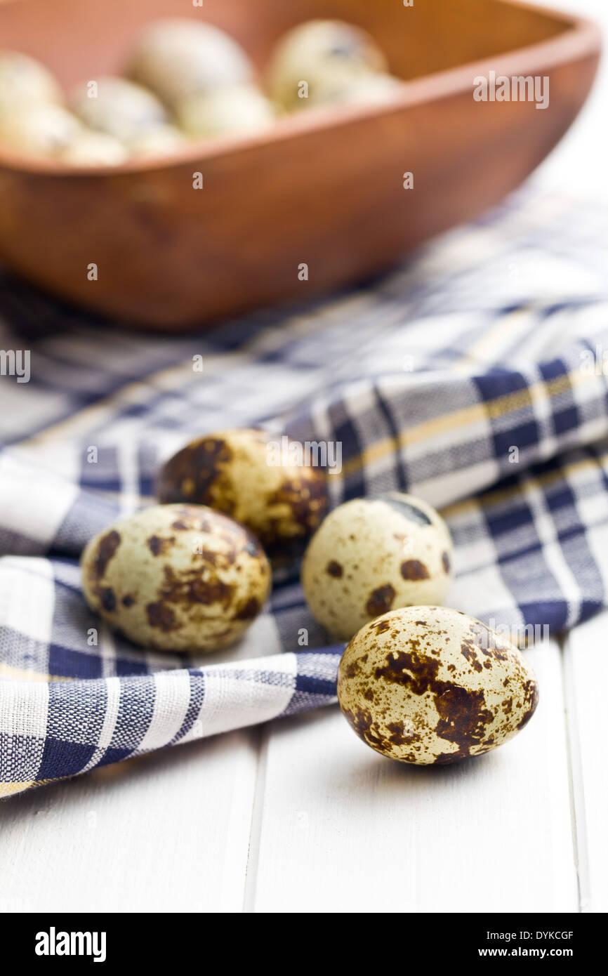 Quail eggs on kitchen table - Stock Image