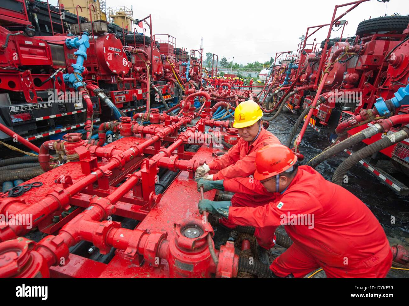 Chongqing, China. 21st Apr, 2014. Workers disassemble facilities after a trial operation at the Fuling work zone Stock Photo