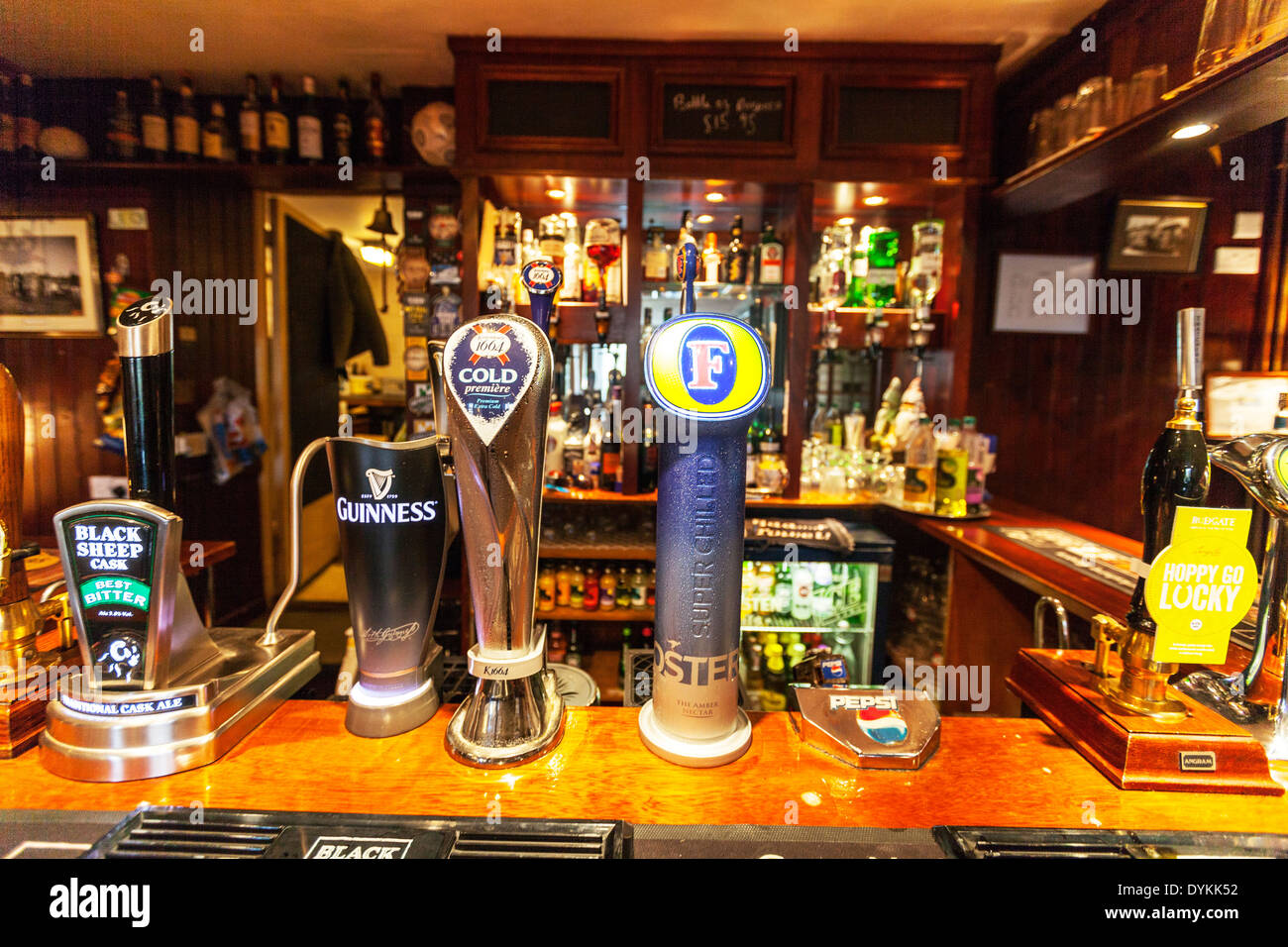 pub bar Beer pumps ale lager fosters Guinness black sheep Yorkshire Dales National Park, UK England GB - Stock Image
