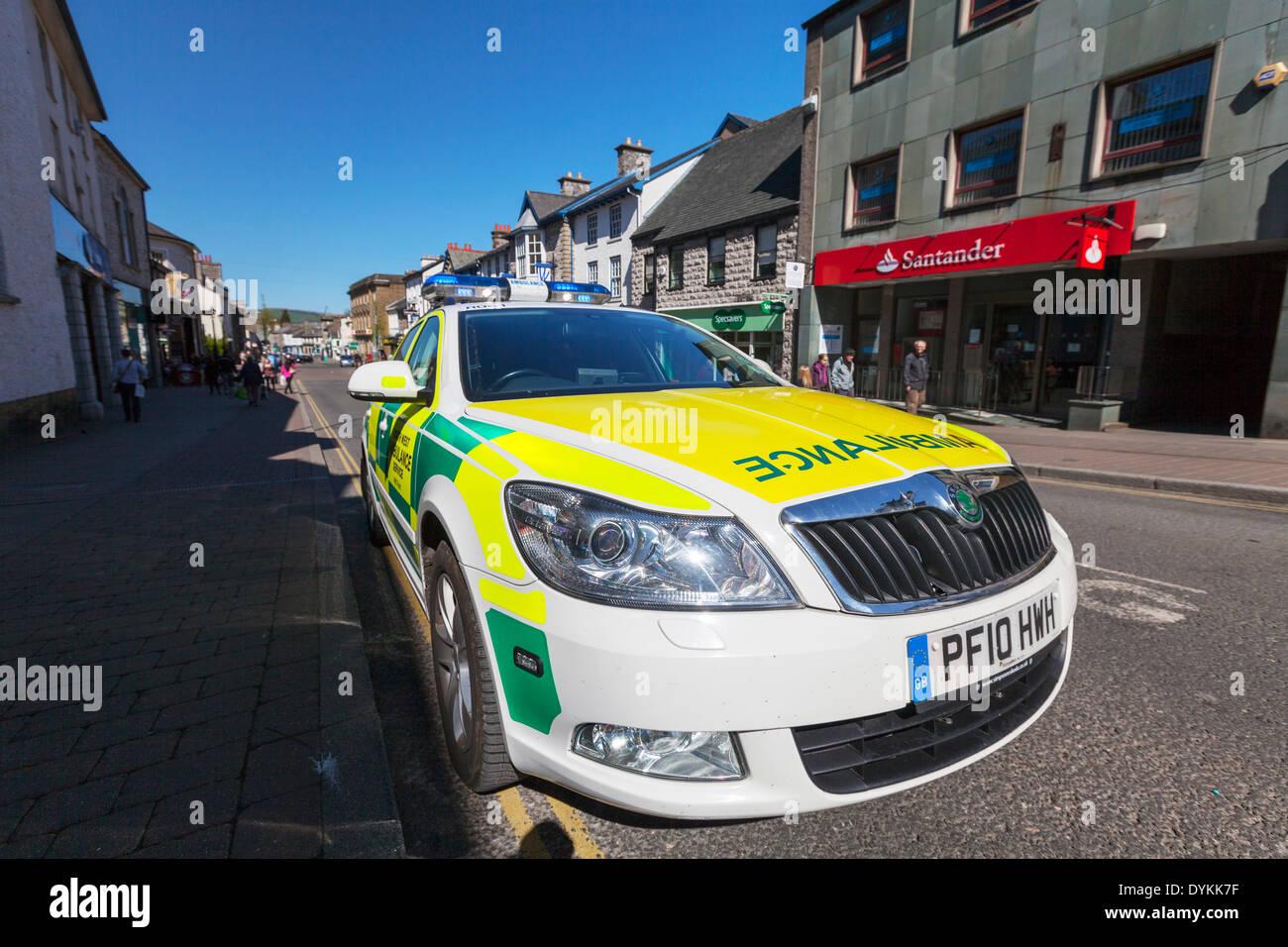 Ambulance car emergency lights flashing parked accident Kendal Town Yorkshire Dales National Park, UK England GB - Stock Image