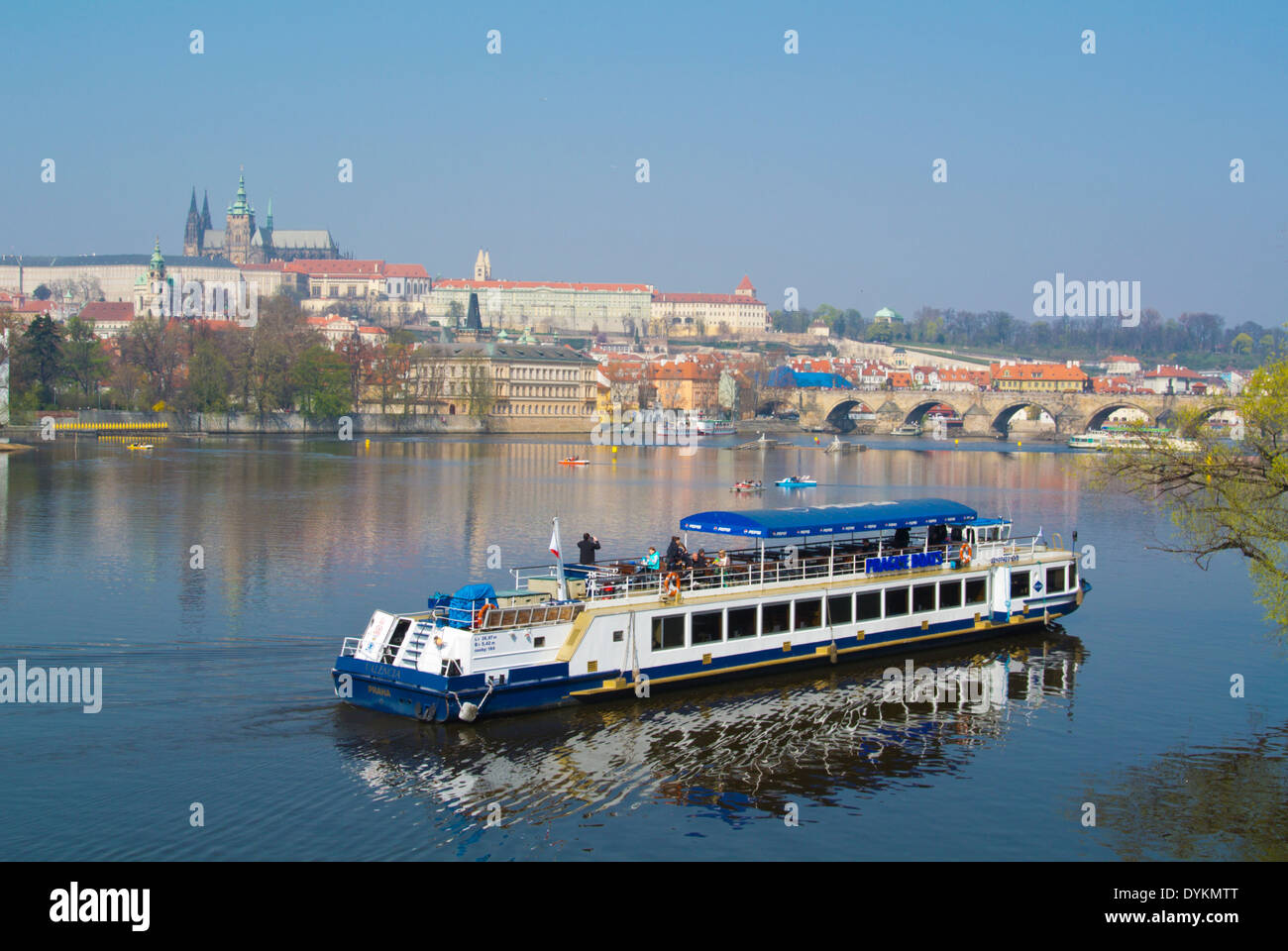 Sightseeing cruise, Vltava river, with Charles Bridge and the Castle in background, Prague, Czech Republic, Europe - Stock Image