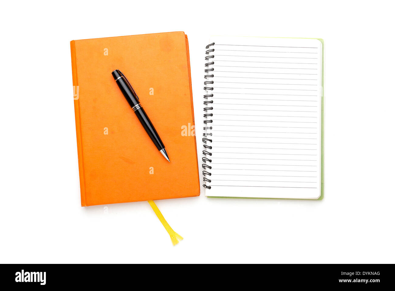 two diaries with ball pen, bookmark, ring binder, one open, one closed. - Stock Image