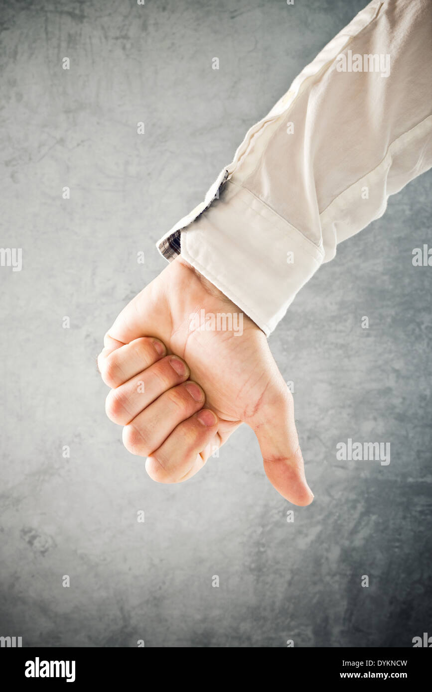 Businessman showing thumb down, disapproval symbol, conceptual image - Stock Image