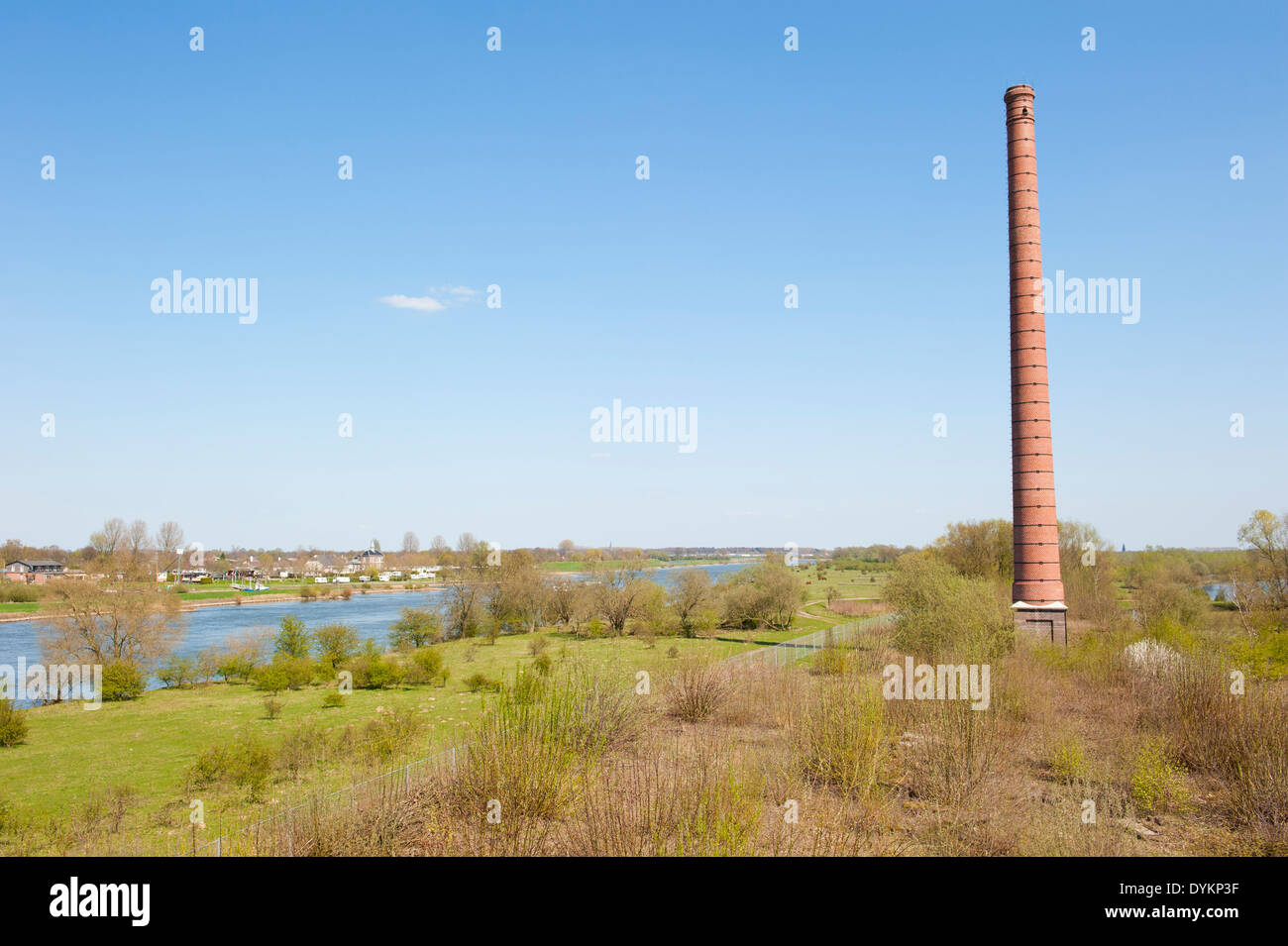 Stone chimney of an old Dutch brick factory in river landscape Stock ...