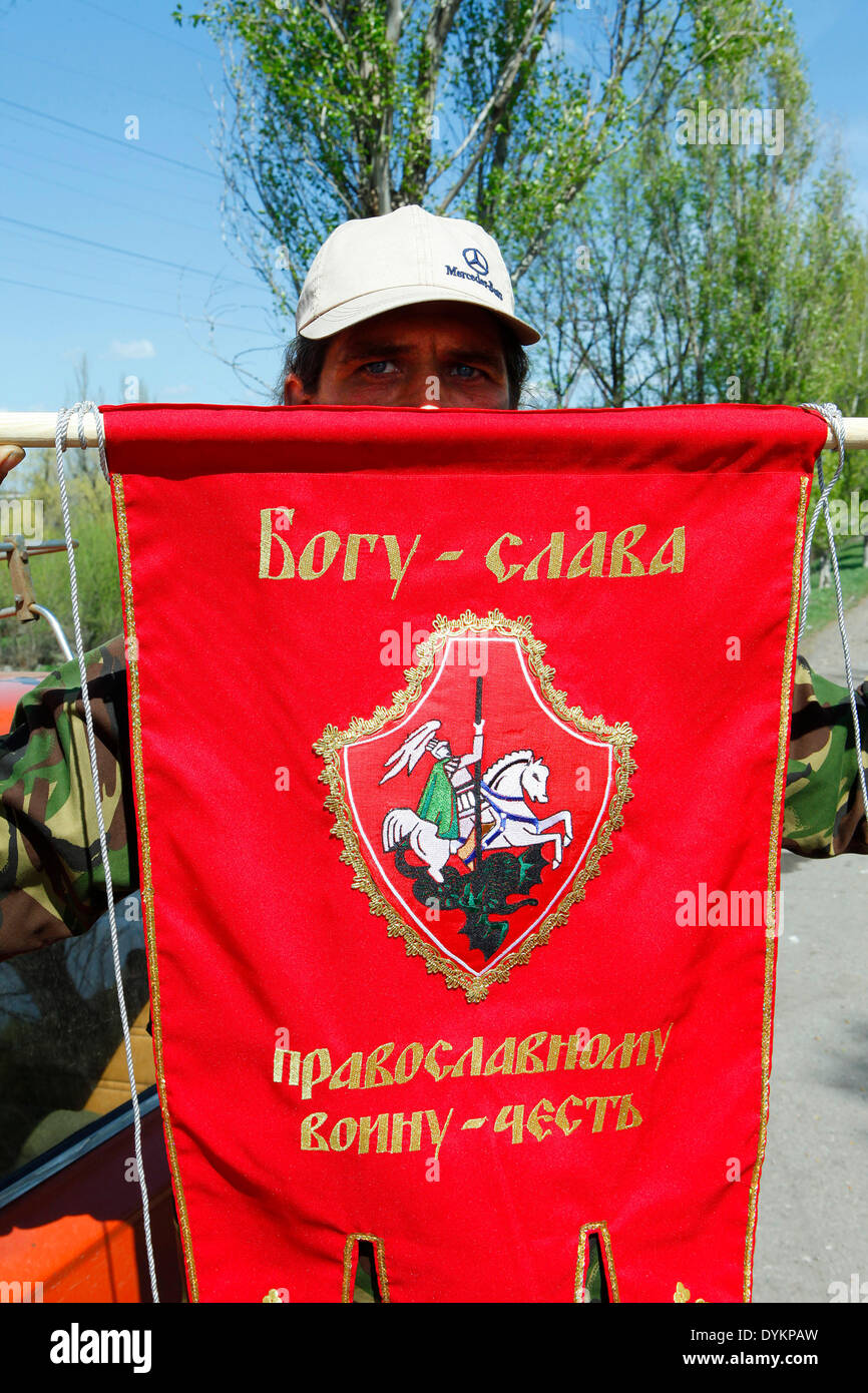 Pro-Russian volunteer show his St. George's drape. the photographer was stopped for few hours by pro-Russian insurgents and later released with a French reporter and a Belarus journalist. - Stock Image