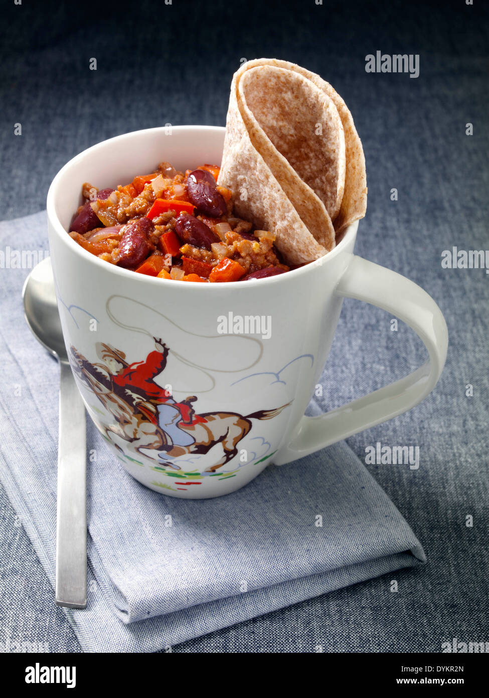 Chilli beef microwaved in a mug - Stock Image