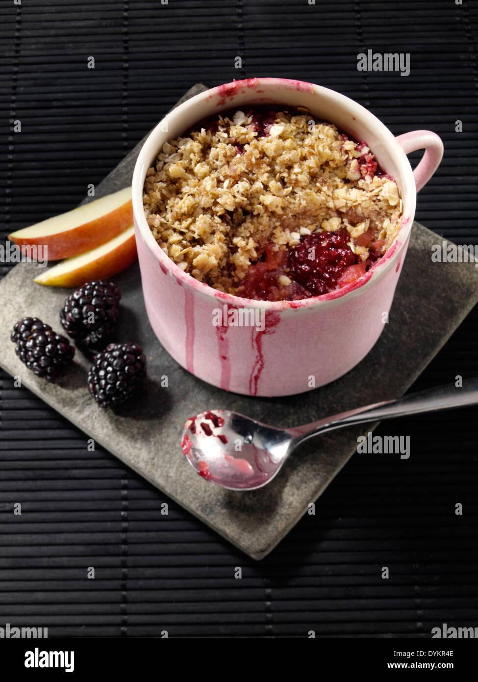 Microwaved apple crumble in a mug - Stock Image